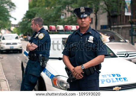 NEW YORK CITY - JUN 27: NYPD Police officers in NYC on June 27, 2012. The New York City Police Department (NYPD), established in 1845, is the largest municipal police force in the United States. - stock photo