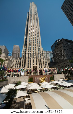 NEW YORK CITY - JUN 15: Rockefeller Center on June 15, 2013 in NYC. Rockefeller Center is a complex of 19 commercial buildings, built by the Rockefeller family, located in Midtown Manhattan - stock photo