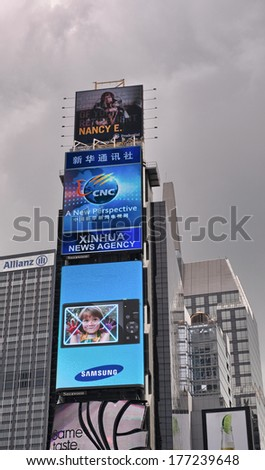 NEW YORK CITY - JUN 16: Times Square, featured with Broadway Theaters and animated LED signs, is a symbol of New York City and the United States, June 16, 2013 in Manhattan, New York City - stock photo