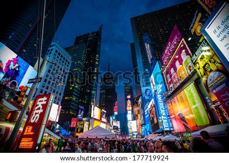 NEW YORK CITY - JUN 3: Times Square, is a busy tourist intersection of neon art and commerce and is an iconic street of New York City and America, Jun 3, 2013 in Manhattan, New York City. - stock photo