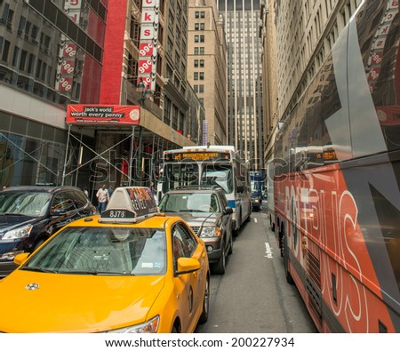 NEW YORK CITY - JUN 14, 2013: Yellow cab rides on city streets. In the city there are more than 13,000 taxis in service. - stock photo