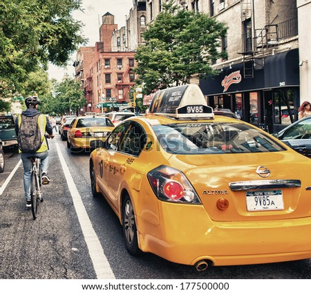 NEW YORK CITY - JUN 11: Yellow cabs along Manhattan streets, June 11, 2013 in New York City. There are more than 13,000 taxis in the city. - stock photo