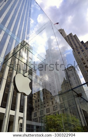 New York City - 9 June; Apple Sore in New York City on Fifth Avenue in June 9 2015, USA. The Store in it self is alla underground except for the 32 - foot glass cube sight in front of the GM building. - stock photo