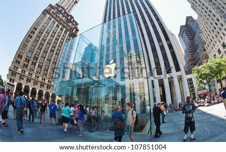NEW YORK CITY - JUNE 23: Apple Store cube on 5th Avenue June 23, 2012 in New York City. As of June 2012, Apple has 363 stores worldwide, with global sales of US$16 billion in merchandise in 2011. - stock photo