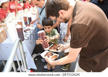 NEW YORK CITY - JUNE 14 2015: Big Apple Barbecue hosted its annual Barbecue Block Party in Madison Square Park drawing thousands of visitors - stock photo
