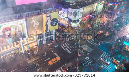 NEW YORK CITY - JUNE 13, 2013: Blurred view of tourists in Times Square. Times Square is a major commercial intersection and neighborhood in Midtown Manhattan. - stock photo