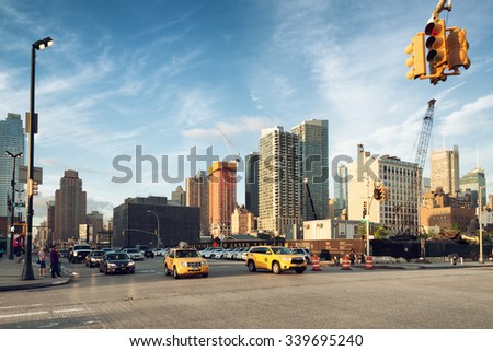 NEW YORK CITY, JUNE 17,2015: cars and taxi in the intersection of 34th St and 11th Ave, along the construction site of 3 Hudson Boulevard, 1.8 million square foot tower that will rise in New York City - stock photo