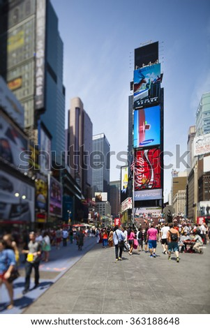 New York City - June 22: Chaotic Times Square crowded with people in New York. Taken with a tilt and shift lens with selective focus on June 22, 2013