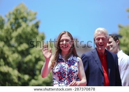 NEW YORK CITY - JUNE 13 2015: Chelsea Clinton and Bill Clinton support former secretary of state Hillary Rodham Clinton as she formally announces her intention to seek the 2016 Democratic nomination for president during a rally on Roosevelt Island - stock photo