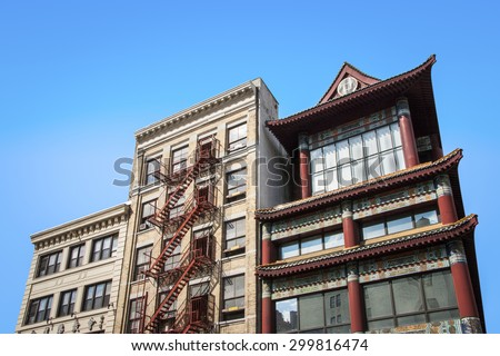 NEW YORK CITY - JUNE 10: Chinese architecture can be seen on Canal Street in Chinatown, New York on June 10, 2013. - stock photo