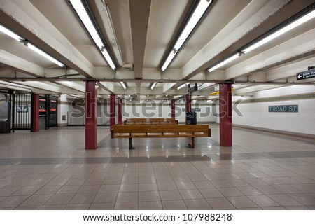 NEW YORK CITY - JUNE 29: Empty interior view of Broad St. subway station in NYC seen on June 29, 2012. This underground station had 1,473,717 passengers in 2011. - stock photo