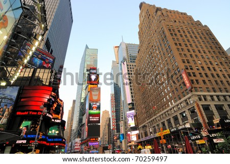 NEW YORK CITY - JUNE 27: Famous Times Square boasts a world class theater district and many other exciting events June 27, 2010 in New York, New York. - stock photo