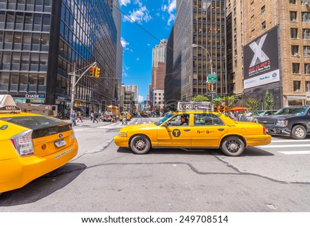NEW YORK CITY - JUNE 12, 2013: Famous yellow cabs in Manhattan avenues. More than 13,000 taxis run on city streets.