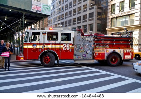 NEW YORK CITY - JUNE 27: FDNY engine 24 truck in Manhattan on June 27, 2013. FDNY is the largest combined Fire and EMS provider in the world - stock photo