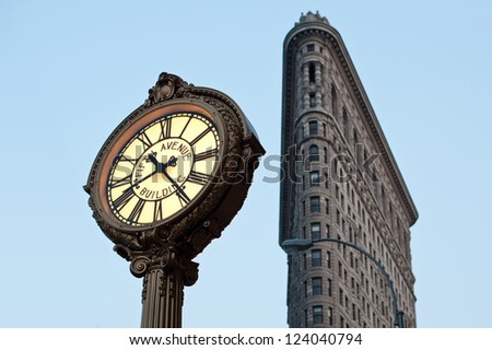 NEW YORK CITY - JUNE 28: Flat Iron building facade on June, 28th 2012 in New York City. Completed in 1902, it is considered to be one of the first skyscrapers ever built. - stock photo