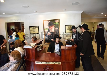 NEW YORK CITY - JUNE 21 2015: followers of the late Lubavitcher Grand Rebbe Menachem Mendel Schneerson gathered at Old Montefiore Cemetery to celebrate the 21st Yahrzeit or anniversary of his passing