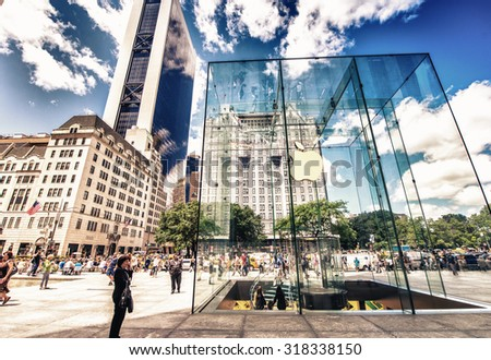 NEW YORK CITY - JUNE 12, 2013: Glass cube building of Apple Store on Fifth Avenue. The cube of glass entrance was designed by Bohlin Cywinski Jackson and has received numerous architectural awards - stock photo