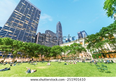 NEW YORK CITY - JUNE 8, 2013: Locals and tourists relax in Bryant Park. The city is visited by more than 50 million people annually. - stock photo