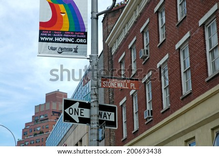 NEW YORK CITY - JUNE 24:  Location for the annual NYC LGBT Gay Pride March on Christopher Street in Manhattan on June 24, 2007. This annual parade attracts thousands of people promoting equality. - stock photo