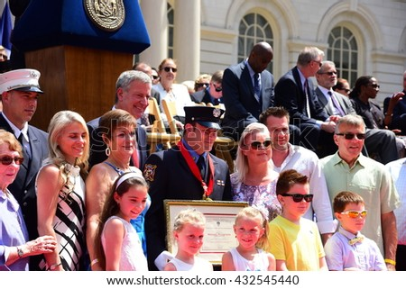 NEW YORK CITY - JUNE 1 2016: Mayor de Blasio & Commissioner Daniel Nigro presided over FDNY medal day on the steps of city hall. Firefighter Michael Ryszetnyk with family & officials