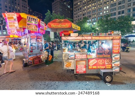 NEW YORK CITY - JUNE 12, 2013: New York street seller in a Manhattan square at night. Food sellers are all over Manhattan offering a variety of street foods. - stock photo