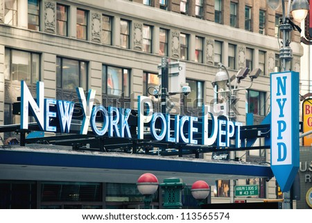 NEW YORK CITY - JUNE 28: NYPD sign. The New York City Police Department, established in 1845, is the largest municipal police force in the United States on June 28, 2012 in New York, NY. - stock photo