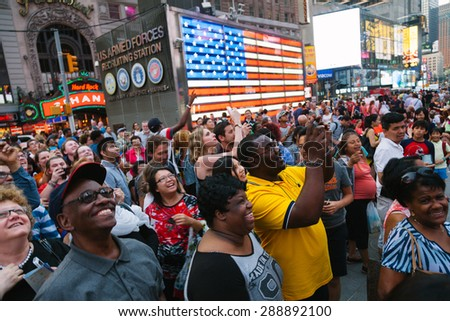 NEW YORK CITY - JUNE 11: People having fun with the Screen Shows in Times Square, one of the most visited landmarks of the world on June 11, 2015 in Manhattan, New York City - stock photo
