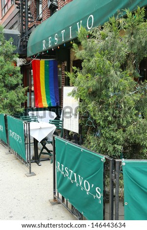 NEW YORK CITY - JUNE 27: Restaurant in Manhattan welcomes customers of 43rd  annual  Pride Parade on June 27, 2013.  - stock photo