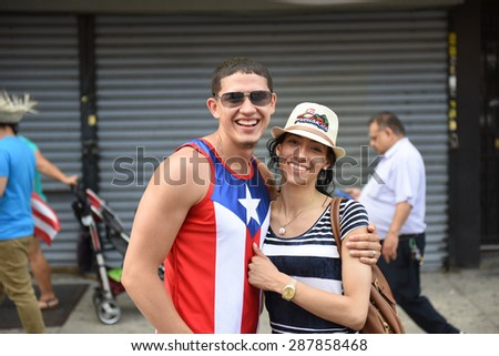 NEW YORK CITY - JUNE 14 2015: the first Sunset Park Puerto Rico Day parade in three decades was held along 5th Avenue in Brooklyn late in the evening to permit attendance at the Manhattan parade - stock photo