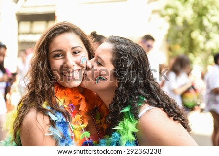 NEW YORK CITY - JUNE 28 2015: the 45th annual LGBT Pride parade drew an estimated two million spectators buoyed by the Supreme Court's Obergefell ruling on same sex marriage. - stock photo