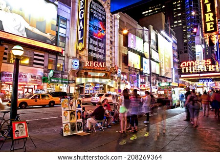 NEW YORK CITY - JUNE 28, 2014: Times Square, famous tourist attraction featured with Broadway Theaters and famous restaurant and store locations in New York City, June 28, 2014 - stock photo