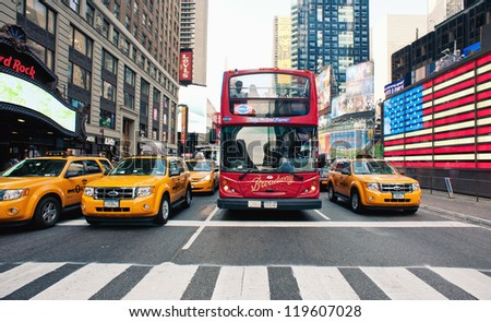 NEW YORK CITY - JUNE 28: Times Square is a busy tourist intersection of commerce Advertisements and a famous street of New York City and US, seen on June 28, 2012 in New York, NY. - stock photo