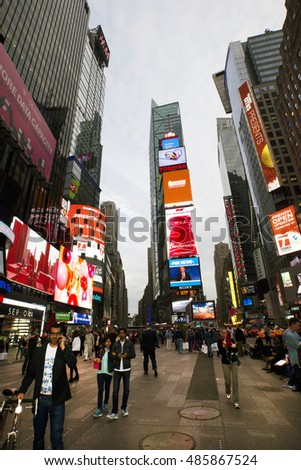 NEW YORK CITY - JUNE 4, 2015:: Times Square, is a busy tourist intersection of neon art and commerce and is an iconicplace of New York City and USA. 40 million of tourists visit New York anually.