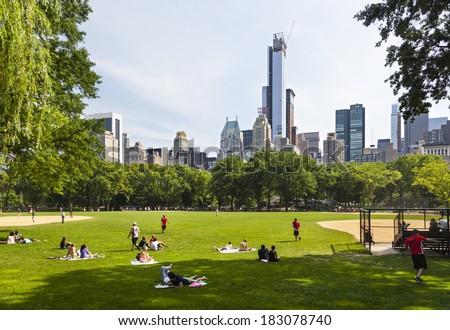 New York City - June 22: Tourist and locals enjoying the sun at the baseball fields in Central Park in New York on June 22, 2013 - stock photo