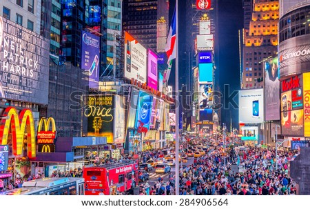 NEW YORK CITY - JUNE 8, 2013: Tourists in Times Square at night. More than 50 million people visit New York every year. - stock photo