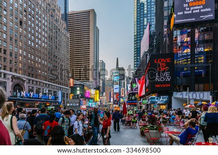 NEW YORK CITY - JUNE 11: Tourists in Times Square, one of the most visited landmarks of the world on June 11, 2015 in Manhattan, New York City
