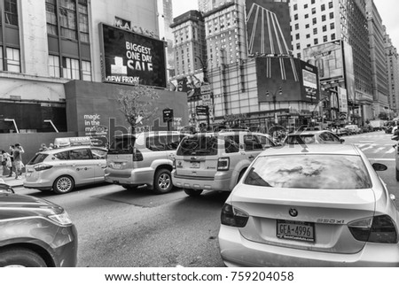 NEW YORK CITY - JUNE 10, 2013: Yellow cabs along city streets. In NYC there are more than 13,000 taxis.