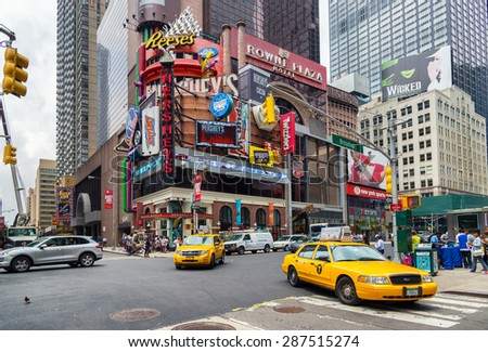 NEW YORK CITY - JUNE 15, 2015: Yellow cabs in Broadway, a busy tourist intersection of commerce Advertisements and theaters. One of the most famous streets of New York City and US - stock photo