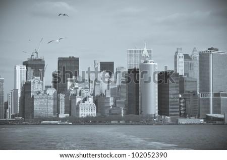 New York City - Lower Manhattan skyline  from Staten Island Ferry boat - split toned - stock photo