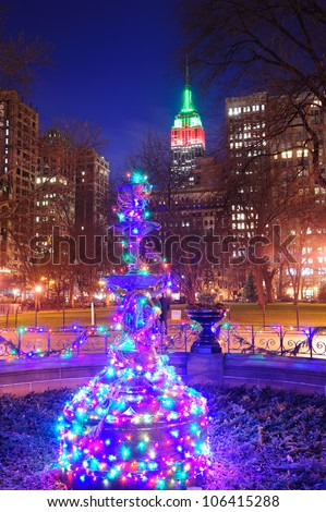 New York City Madison Square park view with Christmas decoration lights and Empire State Building. - stock photo