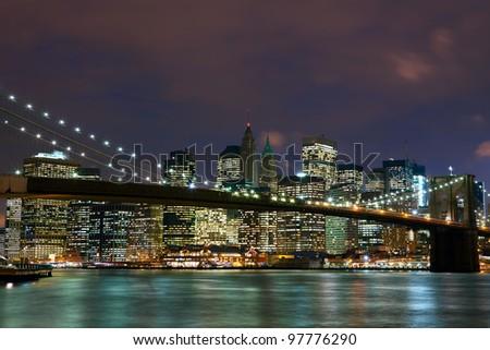 New York City Manhattan and Brooklyn Bridge at dusk - stock photo