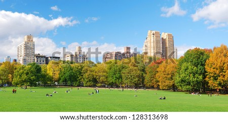 New York City Manhattan Central Park panorama in Autumn with skyscrapers and colorful tree - stock photo