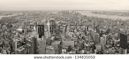 New York City Manhattan downtown aerial view with urban city skyline and skyscrapers buildings in black and white. - stock photo