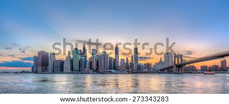 New York City Manhattan downtown skyline and Brooklyn bridge.
