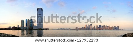 New York City Manhattan downtown skyline and New Jersey at sunset over Hudson River panorama - stock photo