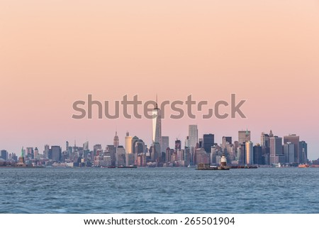 New York City Manhattan downtown skyline at dusk with skyscrapers illuminated over Hudson River panorama. Vertical composition, copy space. - stock photo