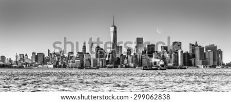 New York City Manhattan downtown skyline at dusk with skyscrapers illuminated over Hudson River panorama. Horizontal composition, copy space. Black and white image. - stock photo