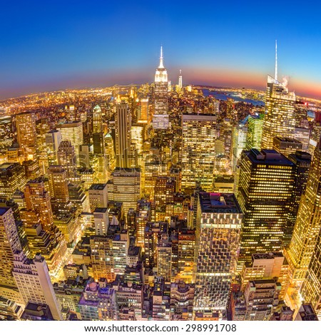 New York City. Manhattan downtown skyline with illuminated Empire State Building and skyscrapers at dusk seen from observation deck. Square fish eye composition. - stock photo