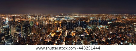 New York City Manhattan east side view panorama at night with skyscrapers and East River. - stock photo