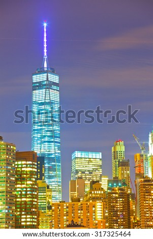 New York CIty, Manhattan famous landmark buildings of financial district at colorful sunset - stock photo
